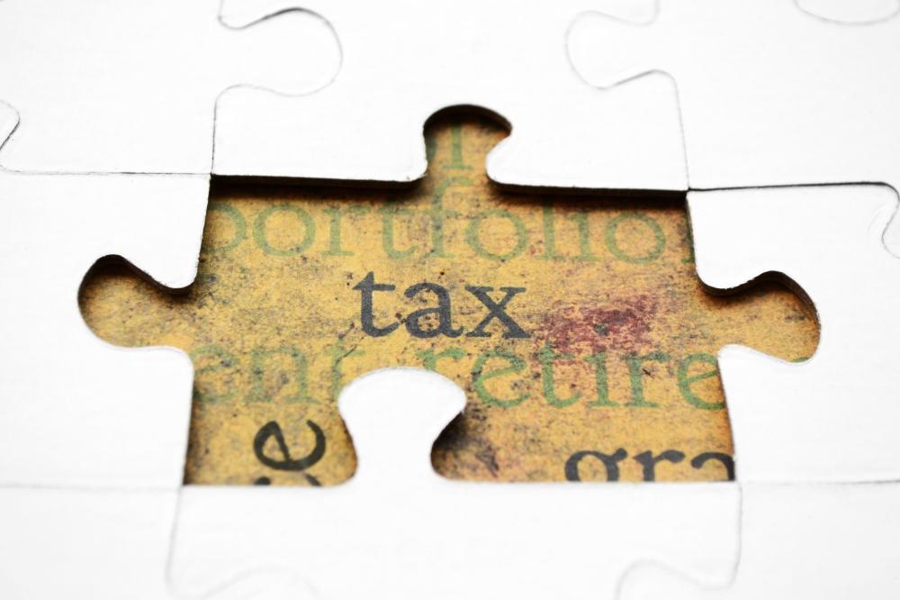 Tax puzzle concept
